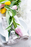 Table setting with tulips Royalty Free Stock Images