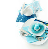 Table setting in turquoise color-1. Table setting in turquoise color with porcelain rabbit stock images