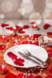 Table setting for valentines day. With petals Stock Images