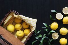 Table setting with variety shape of lemons and lemons leaves Royalty Free Stock Image