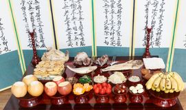 Table setting with various fruits and foods for Korean traditional Holiday. Seoul, Korea - Feb 5 2019: Table setting with various fruits and foods for Korean stock photos