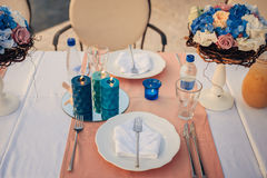 Table setting at a wedding banquet. Decoration flowers Stock Image