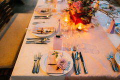 Table setting at a wedding banquet. Decoration flowers Royalty Free Stock Photo