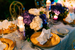 Table setting at a wedding banquet. Decoration flowers Stock Photos