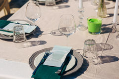 Table setting at a wedding banquet. Decoration flowers Royalty Free Stock Photography