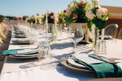 Table setting at a wedding banquet. Decoration flowers Royalty Free Stock Image