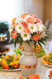 Table setting for a wedding or dinner event. With flowers in vase Stock Photo