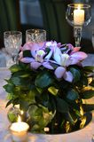 Orchid bouquet on the wedding table reception Royalty Free Stock Photography