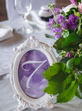 Table setting at wedding reception. Floral decoration and styliz Stock Image
