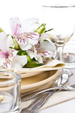 Table setting with white alstroemeria flowers Royalty Free Stock Photos