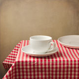 Table setting with white coffee cup Stock Photography