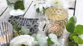 Table setting with white flowers stock video