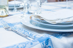 Table setting with white plates, vintage silverware, linen napki Royalty Free Stock Photography