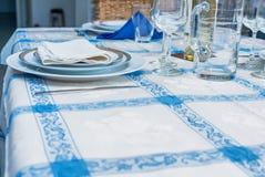 Table setting with white plates, vintage silverware, linen napki Royalty Free Stock Photos
