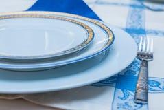 Table setting with white plates, vintage silverware, linen napki Royalty Free Stock Image