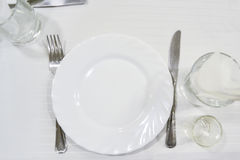 Table setting. On white tablecloths Stock Photos