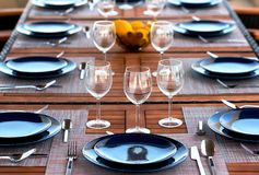Table setting with a wine glasses, cutlery and plates stock photo