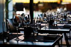Table setting. With wine glasses in restaurant Stock Images