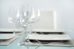 Table setting with a wine glasses royalty free stock image