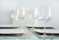 Table setting with a wine glasses stock photography