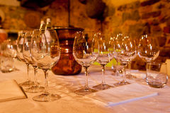Table Setting for Wine Tasting. Table Set With Wine Glasses for Wine Tasting With Water Bottles and Spittoon in Background royalty free stock image