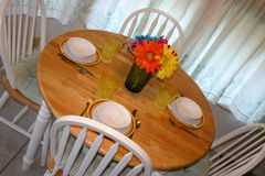 Table Settings at an angle. A setting for four at the table angled Stock Photo