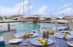 Table settings at restaurant on island's seaside Royalty Free Stock Photo