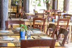 Table setup in outdoor cafe, small restaurant in a hotel, summer Stock Photos