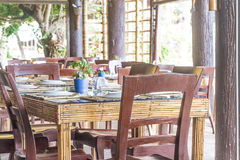 Table setup in outdoor cafe, small restaurant in a hotel, summer. Vacations, meal time stock images