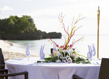 Table setup on tropical beach Royalty Free Stock Images
