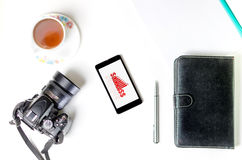 Table showing business graph,pen,cup of tea and notebook. Top view of a table showing business graph,pen,cup of tea and notebook isolated in white background Royalty Free Stock Photography