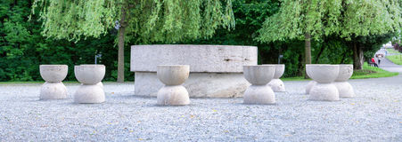 Table Of Silence Panorama Targu Jiu. The Table Of Silence Is Made From Limestone Originally The Twelve Chairs Were Much Closer To The Table And Were Arranged In Stock Images