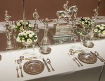 Table with silverware Stock Photography