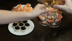 On the table is a snack and champagne. Caviar. 4k UHD 3840x2160 stock video
