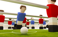 Table soccer. Game red versus blue players Stock Photos