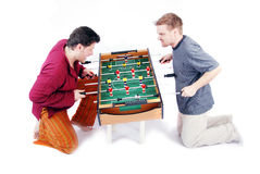 Table soccer. Two crazy man play table football soccer game Royalty Free Stock Photography