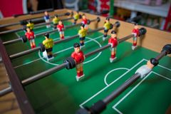 Free Table Soccer. Foosball In A Children`s Playroom. Close-up During The Game. Soccer Table Kid`s Home Toys, Football Family Game Royalty Free Stock Image - 163873526