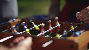 Table soccer. Foosball. Unknown person playing table football. Russia, Novosibirsk, 2016: Table soccer. Foosball. Unknown person playing table football. Unknown stock footage