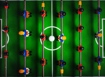 Table Soccer or Football Kicker Game. Table Soccer or Foosball Kicker Game, Top View, Selective Focus, Retro Tone Effect Stock Photo