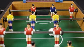 Table soccer low play. Playing a table soccer foosball match. Low angle stock video footage