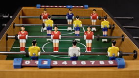 Table soccer low score. Scoring while playing a table soccer foosball match. Low angle stock video