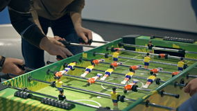 Table soccer. People playing table football