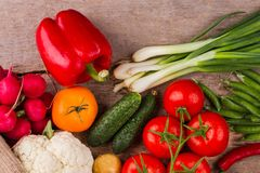 Table with some vegetables. Cooking salad on wood. Top view. close up royalty free stock image