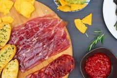 Table with spanish tapas. Table with spanish jamon and chorizo tapas, picnic table stock photos