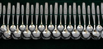 Table spoons on a dark background Royalty Free Stock Photos