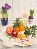 Table with spring flowers and a text message with I love mom Stock Photo