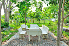 Table and stone stool in the garden. Royalty Free Stock Photo