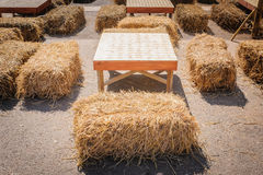 Table and straw chair. Royalty Free Stock Image
