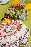 Table with strawberry cake Stock Photos