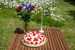 Table with strawberry cake and decorations Stock Photography
